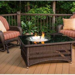 Outdoor GreatRoom - Outdoor GreatRoom Naples Fire Pit Table Multicolor - NAPLES-CT-B-K - Shop for Fire Pits and Fireplaces from Hayneedle.com! Part coffee table and part fire pit the Outdoor GreatRoom Naples Fire Pit Table is wholly perfect for your patio. The tempered glass top has a removable off-center piece that holds the crystal fire stainless steel burner complete with glass fire gems and an electronic piezo with an adjustable flame. Plus the powder-coated aluminum frame features all-weather balsam wicker in a Dora brown finish - a fashionable way to conceal the liquid propane tank (not included). A natural gas adapter also comes included.About Outdoor GreatRoom CompanyWith over 50 patents to its name the Outdoor GreatRoom Company is one of the most innovative names in gas fireplaces and outdoor design period. Since 1975 Dan Ron Steve and Ger have produced a yard of amazing products like the Heat-N-Glo that have changed the industry. In fact they want to change the way you think about your backyard or patio. It's about bringing the luxury and comfort of the living room outside to make an Outdoor Room. They want you to literally think outside the box. To make that beautiful concept a reality Outdoor GreatRoom designs manufactures and sells pergolas outdoor kitchens grills outdoor furniture fireplaces fire pits lighting and heating products. There's no better name in outdoor leisure than this fine Minnesotan company.