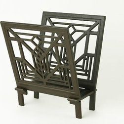 Abstract Tulip Magazine Rack - Adapted from a window designed in 1911 for a resort hotel in Lake Geneva, Wisconsin, this Abstract Tulip Magazine Rack is a must-have for a vintage modern–inspired décor. The rack is made from cast aluminum with a dark bronze finish.