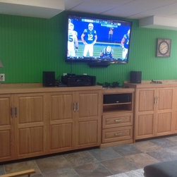 Dual Murphy beds for a game room - Two twin Murphy beds with center storage cabinet, set up and ready for the big game!