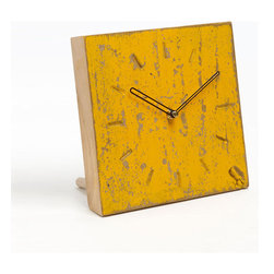 Mustard Woodblock Clock - Sleek and chic, this wood block clock has a rustic modern sensibility perfect for any home or office. Featuring Seiko workings for consistent movement, this distressed yellow clock provides a stylish note and keeps track of your day. It can stand up on its own or be displayed on a wall.