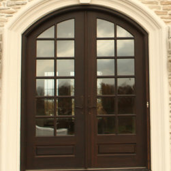 Hershey Hill arch top true divided lite mahogany double entry door - Updated classic elegance and made in USA, this dark chocolate finished mahogany door stands 8' tall and is definitely the focal point of this lovely home's exterior.