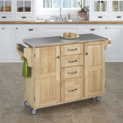 HomeStyles - Wooden Kitchen Cart - Add a unique touch of elegance with this kitchen cart! It features a stainless steel top with an easy clean surface this piece provides simple clean up and a sanitary way to prepare your food. It has a natural wood frame cabinet for storage. * Four easy open utility drawers. Two cabinet doors open to storage with adjustable shelf inside. Handy spice rack with towel bar. Paper towel holder. Stainless steel top. Heavy duty locking rubber casters for easy mobility and safety. Made from Asian hardwood. Natural finish. Made in Thailand. 48 in. L x 17.75 in. W x 35.5 in. H. Cart Assembly Instruction. Top Assembly InstructionHome Styles' Create-a-Cart is a unique and refreshing solution for kitchen utility.
