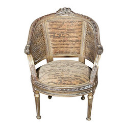 MBW Furniture - French Traditional Antique Finish Upholstered  Rattan Occasional Arm Chair - This is a beautiful French style reproduction traditional antique finish upholstered rattan arm chair. It features a beautiful solid wood frame richly embellished with fancy fretwork, decorative beads, acanthus leaves and a pierced floral accent on its top rail. It is very comfortable and its back and seat have beautiful upholstery with distinguished patterns and text and it also has luxurious trim hemming around its edges. In addition it has attractive gilded rattan sides and elegant fluted legs. Add a touch of elegance to your home decor with this beautiful piece of furniture!
