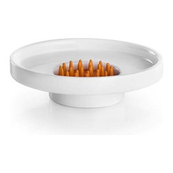 WS Bath Collections - Soap Dish in White and Orange - Includes soap dish grid. Contemporary design. Designer high end quality. Warranty: One year. Made from ceramic and silicon. Made by Lineabeta of Italy. 4.7 in. Dia. x 1.2 in. H. Spec SheetUnique and fine bath accessories and complements, that provide inspirational solutions for every decor.
