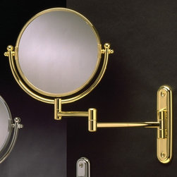 "Taymor - Wall-Mount Swinging Arm 4X Magnifying Mirror - Features: -Swing arm mirror. -Available in Chrome and Polished Brass finishes. -7.25"" diameter rotating mirror. -4X magnification on reverse side. -Plated steel construction. -Dual arm action. -Exposed screw mount. -Wipe with a clean soft damp cloth, do not use harsh chemicals or abrasives. -Mounting hardware and instructions included. Specifications: -Manufacturer provides one year warranty against defects. -Overall dimensions: 12"" H x 17"" W x 7.25"" D."