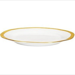 """Caroline Porcelain Salad Plate, Set of 4, Gold - Make a celebration even more memorable with a thoughtful gift. Handcrafted with gently uneven rims, our new Caroline Registry dinnerware has understated glamour that's just right for both formal and casual settings. We've wrapped it in a beautiful gift box so it's ready for giving on any special occasion. Dinner Plate: 11"""" diameter, 1"""" high Salad Plate: 8.5"""" diameter, 1"""" high Bowl: 9"""" diameter, 2"""" high; 5.5 fluid ounces Cup: 4.5"""" wide x 3.5"""" deep x 3"""" high Saucer: 6"""" diameter Made of porcelain with a glazed finish. Gold trim. Set of 4, choose dinner plate, salad plate, or cup-and-saucer set. Packaged in a beautiful PB storage box. Dishwasher-safe. Gold is Catalog / Internet only. Read more on our blog about the inspiration behind this product."""