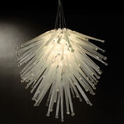 "Trend Lighting - Cassini Chandelier by Trend Lighting - Like the icy plumes of water discovered by the Cassini spacecraft on Saturn's moon, Enceladus, the Trend Lighting Cassini Chandelier features a veritable geyser of Icicle Glass. The impressive cluster of textural, sparkling glass spikes casts an unearthly glow around a space. Available with Amber or Clear Icicle glass or a mix of the two.Planted and nurtured in a California basement more than 20 years ago, and founded on the principles of quality and innovation, Trend Lighting has grown to create products to complement a variety of styles, from contemporary to classic traditional.The Trend Lighting Cassini Chandelier is available with the following:Details:Icicle glass shadeMetal framePolished Chrome finishRound ceiling canopy42"" suspension chainUL ListedOptions:Shade: Amber and Clear Icicle, Amber Icicle, or Clear Icicle.Lighting:Six 40 Watt 120 Volt Type G9 Halogen lamps (included).Shipping:This item usually ships within 1 week."