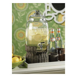 "Zodax - Glass Lemonade Beverage Dispenser on Rattan Base - Tropical chic.. This Collection by Zodax has a fresh appeal with touches of tradition. Assure that party favorites like sangria, punch and even water are always on standby with this glass lemonade drink dispenser that sits atop a rattan base. The Wicker Pedestal Beverage Server makes refills Fuss-Free as you simply slide your glass under this stainless steel leak-proof turn spout. The bamboo stand lends the server a modern air as you display the lemonade dispenser as your buffet server at any outdoor party, wedding or even spa accessory. * 1.7 gallons * 21"" Tall"