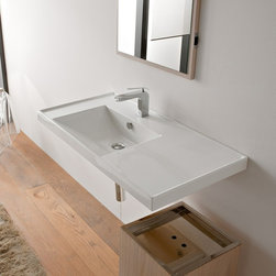 Scarabeo - Rectangular White Ceramic Self Rimming or Wall Mounted Bathroom Sink - Rectangular white ceramic self rimming or wall mounted sink. Stylish sink comes with overflow and no hole, one hole or three hole options. Made in Italy by Scarabeo. Made out of white ceramic. Contemporary design. Counter space on right side. Includes overflow. Standard drain size of 1.25 inches. ADA compliant. Because the sink has multiple installations, the back side is not glazed.