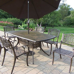 Oakland Living - Mississippi 7 Pc Dining Table Set w Umbrella - Set includes Dining Table, 6 Chairs, and Plus an Umbrella, and Base. Made of Rust Free Cast Aluminum Construction. Table top is 70 inches by 40 inches and has opening for an umbrella. Easy to follow assembly instructions and product care information. Stainless steel or brass assembly hardware. Fade, chip and crack resistant. 1 year limited. Hardened powder coat finish in Antique Bronze for years of beauty. Antique Bronze finish. Some assembly required. 70 in. W x 40 in. L x 29 in. H (258 lbs.)This 70 by 40 inch dining set is the prefect piece for any outdoor dinner setting. Just the right size for any backyard or patio.