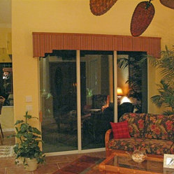 Cornice with wood trim over sliding glass doors in a family room
