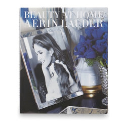 Beauty at Home - This gorgeous coffee table book by Aerin Lauder would be perfect for any design junkie. It includes photographer Simon Upton's beautiful images of Aerin's homes as well as useful decorating pointers.