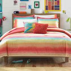 Teen Vogue - Teen Vogue Electric Beach Comforter Set Multicolor - 200903 - Shop for Bedding Sets from Hayneedle.com! The colorful tie dye Teen Vogue Electric Beach Sheet Set is to DYE for! Boasting bright stripes and sunny hues this comforter set is reminiscent of a tropical sunset making for the perfect place to drift off into dreams of endless summers. With its tropical pattern on one side and a solid coral hue on the other it is reversible so you can easily switch things up. Complete the look with the matching Teen Vogue sheet set and throw pillows (sold separately) to hold on to that summer feeling all year round.Full/Queen DimensionsComforter: 86L x 86W in.Sham: 26L x 20W in.Twin DimensionsComforter: 86L x 68W in.Sham: 26L x 20W in.About Teen VogueFrom the name that brings you the latest and greatest fashion trends for teens Teen Vogue now brings you a line of bedding to make your room or dorm as stylish as you. The fashion-forward Teen Vogue designers take the most current trends and translate them into inspired bedding sets and accessories in enough styles and colors to fit any taste all at an affordable price. Now that's always en vogue.