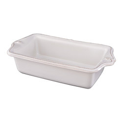 Berry and Thread Loaf Pan - Whitewash - Breads and cakes rise well and look luxuriously gourmet in the deep Loaf Pan from the Berry and Thread line of luxury oven-to-table ceramics. The stoneware baking dish, which is crafted with generously-sized, scalloped handles, bears the dimensional yet pared-down motifs of this elegantly rustic collection, simplified versions of classic fruit and garden motifs from European ceramics.