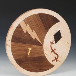 Sleeth Electric logo on round cutting board -