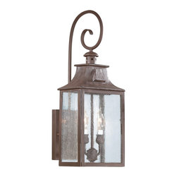 "Troy - Newton Collection 23"" High Outdoor Wall Light - This handsome outdoor lighting collection features classic carriage house detailing and style accents. Features hand forged iron with an old bronze finish. Clear seeded glass panels add to the visual appeal. Chimney style detailing up top. Takes two 60 watt candelabra bulbs (not included). 23"" high. 8 3/4"" wide. Extends 9"" from the wall.  Old bronze finish.  Takes two 60 watt candelabra bulbs (not included).   23"" high.  8 3/4"" wide.  Extends 9"" from the wall."