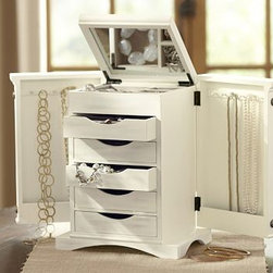"Ultimate Jewelry Box, White - Designed with the same expert craftsmanship and attention to detail our furniture is known for, this beautiful jewelry box is generously sized to neatly stow your entire collection. It features multiple drawers and compartments for jewelry and accessories. Stylish and compact when closed, its top opens to reveal an interior mirror, and a compartment with three smaller compartments and a front ring compartment; a door on either side opens to provide hooks for hanging necklaces. Multiple drawers on the front store jewelry and accessories. 10"" wide x 7"" deep x 12.5"" high Made of MDF with a white painted finish. Interior mirror. Drawer is lined with linen. The interior of each door has six hooks for hanging jewelry. Metal rivet details. Doors have a magnetic closure. Monogramming is available at an additional charge. Monogrammable with 1 letter only. Monogram will be placed in the lower right corner of the inside mirror."