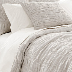 Smocked Dove Grey Duvet Cover - Gentle depths give a sense of secrecy and tactile pleasure to the Smocked Dove Grey Duvet Cover, a sophisticated example of richness fused with restraint.  Its light cotton fabric is puckered into vertical bands of ruching so the texture under your hand is always touchable and appealing, organic layers of pleats giving interest and dimension as well as dressmaking details to the bed.