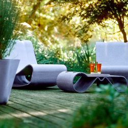Loop Chair Mid-Century Modern Outdoor Chair for Patio, Courtyard, Pool or Garden - The Willy Guhl Loop Chair from Stardust Modern Design is the quintessential modernist outdoor chair.  An icon of Swiss mid-century modern design; the Loop Chair is perfect for modern landscape design ideas and can be used as a pool side chair, patio chair, garden chair or for your mid-century modern indoor atrium (example Eichler Houses, Cliff May, Donald Wexler and Richard Neutra).  It matches well with design from the period including Eames Design and George Nelson design but it looks equally stunning in a minimalist contemporary house from the likes of Richard Meier.  The Loop Chair (also known as the Beach Chair) was designed by Swiss industrial designer Willy Guhl in 1954. It quickly became a classic of 20th century furniture design.  Available from http://www.stardust.com/loopchair.html
