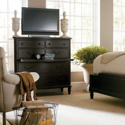 features such as a fold down front drawer that can be used for display ...