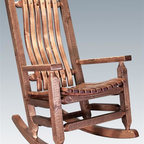 Montana Woodworks - Rocking Chair in Stained and Lacquered Finish - Built with the sturdiest construction methods. Sprayed with three coats of premium grade, clear lacquer. Handcrafted. Timbers and trim pieces. Sawn square for rustic timber frame design. Heirloom quality. Durable build, fit and finish. Solid lodge pole pine legs and trim. Made from American solid grown wood. Made in USA. No assembly required. 27 in. W x 33 in. D x 44 in. H (35 lbs.). Use and Care Instructions. WarrantyThe artisans rough saw all the timbers and accessory trim pieces for a look uniquely reminiscent of the timber framed homes once found on the American frontier. This cozy lodge pole pine rocking chair will ease your worries away with its gentle back and forth rocking motion. You will be pleased with the lasting artistry and quality materials of this chair; your granddaughter can rock her child to sleep much as you rocked her mother years before!