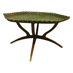Used Brass Moroccan Tray With Spider Leg Base - This is a classic Moroccan Mid-Century piece, with a beautiful brass tray top featuring a hammered floral pattern. The legs are in great, glossy condition and the tray has a lovely antique patina that has not been polished, so as to allow the new owner the option to keep it aged if desired.