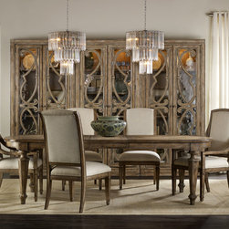 Hooker Furniture Solana Dining Room Collection - Solana Collection by Hooker Furniture. Artfully done inlays, scrolled marquetry, exuberant shapes and an understated scale create a livable resort feeling suitable for homes from countryside villa to suburban dwelling. While Solana takes traditions to heart, the overall feel is an unpretentious casual elegance, with a light and airy touch. The soft, wire-brushed finish is a light caramel latte color with subtle lacy white hang up and a gray undertone. Selected pieces have a shimmery metallic accent finish in a lovely champagne color. Mixed media gives a sophisticated casual feel, with mirrored backs on a signature panel bed, bookcase, console and cocktail table, and a stone base on a round dining table, along with a stone-top nightstand.