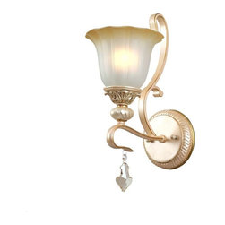 Gold Finish Wall Sconce with Flower Shaped Glass Shade - Classy and magnificent, the unique wall sconce is a beautiful addition to your interiors. It features a resin base in an imperial gloden finish and an amber glass shade in a flower shape. It casts a beautiful and warm light that helps lighten up your space.