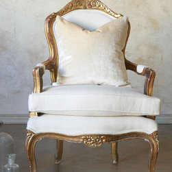 Antique Single Louis XVI French Style Gold Gilt Armchairs - This antique, Louis XVI, French-style, gold gilt armchair is a perfect example of the garnered Edwardian taste. It would be found in the Downton estate drawing room with its formal gilt finish.