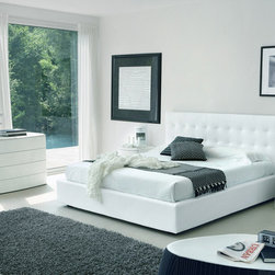 Made in Italy Leather High End Elite Furniture - White color Italian bedroom set with high headboard bed. Well-appointed is the word to describe this bedroom collection that combines conventionality with its curved outlines and bomb-shaped surfaces.