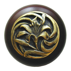 """Inviting Home - Tiger-Lily Walnut Wood Knob (antique brass) - Tiger-Lily Walnut Wood Knob with hand-cast antique brass insert; 1-1/2"""" diameter Product Specification: Made in the USA. Fine-art foundry hand-pours and hand finished hardware knobs and pulls using Old World methods. Lifetime guaranteed against flaws in craftsmanship. Exceptional clarity of details and depth of relief. All knobs and pulls are hand cast from solid fine pewter or solid bronze. The term antique refers to special methods of treating metal so there is contrast between relief and recessed areas. Knobs and Pulls are lacquered to protect the finish. Alternate finishes are available. Detailed Description: A very detailed and beautiful knobs are the Tiger Lily knobs. They are very delicate and bears a lot of positive history. The Tiger Lily is an orange flower that is covered in spots. It has been a useful medical remedy for many centuries. Its scent is said to suppress aggressive behavior and promotes overall good feeling. The smell is said as a superstition to give whoever smells it freckles."""
