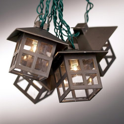 "Lamps Plus - Arts and Crafts - Mission Mission Style Lantern String Party Lights - Perfect for entertaining each of the lanterns on this 10 piece casts an alluring light. Safe to string indoors or outside this set also includes an end connector spare bulbs two fuses and green wire. Bronze finish. Mission-style lanterns. For indoor or outdoor use. 9.6 watt bulbs included. Strand is approximately 11 feet 6 inches long. Each lantern is 3"" tall.  Bronze finish.   Mission style.  For indoor or outdoor use.   9.6 watt clear bulbs (and spares) included.   Strand is approximately 11 feet 6 inches long.  Each lantern is 3"" tall."
