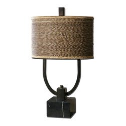 Uttermost - Stabina Metal Table Lamp - Rustic Bronze Metal With Burnished Edges And A Black Marble Foot. The Oval Drum Shade Is Brown And Tan Woven Rattan With Decorative Trim. Number Of Lights: 2, Shade: Oval Drum Shade, Shade Size: Height: 11, Top: 10w X 17d, Bottom: 10w X 17d, Voltage: 110, Wattage: 60w, Bulbs Included: No