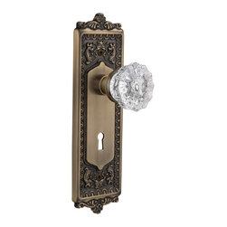 Nostalgic Warehouse - Nostalgic Egg and Dart Plate with Crystal Knob and Keyhole in Antique Brass - With its distinctive repeating border detail, as well as floral crown and foot, the Egg & Dart Plate in antique brass resonates grand style and is the ideal choice for larger doors. Add our Crystal Knob, with its smooth center flawlessly flowing into fluted edges, for a striking match. All Nostalgic Warehouse knobs are mounted on a solid (not plated) forged brass base for durability and beauty.