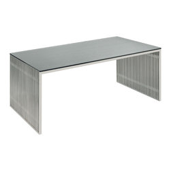 Nuevo Living - Amici Dining Table - Whoever told you a dining table had to be a slab of wood with four legs was sadly misinformed. This modern marvel — a distinctive frame of brushed stainless steel and a slim, tempered glass top — turns everyday meals into extraordinary experiences.