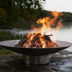 "Frontgate - Stainless Steel Fire Pit - Each Fire Pit is individually tagged and numbered by the artist. The all stainless steel construction is rust and corrosion resistant. An impressive 46"" diameter and low profile allow for large fires. Handsome polished base keeps the bowl steady and secure. Handcrafted in the USA. Enjoy the crackle of the logs and the beauty of an open flame with the Stainless Steel Fire Pit. Designed by functional steel artist Rick Wittrig, this Fire Pit Art is handcrafted from 1/4"" thick 304 stainless steel, ensuring that it will last a lifetime.  .  .  .  .  ."