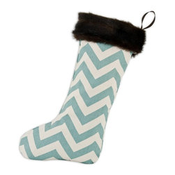 Chooty & Co. - Chooty and Co. Zig-Zag Village Blue with Taline Fur Cuff Christmas Stocking - TT - Shop for Holiday Ornaments and Decor from Hayneedle.com! Santa won't miss the Chooty and Co. Zig-Zag Village Blue with Taline Fur Cuff Christmas Stocking. This eye-catching design features a dynamic zig-zag pattern in village blue and white and features a Taline fur band with loop for quick and easy hanging from your mantel. About Chooty & Co.A lifelong dream of running a textile manufacturing business came to life in 2009 for Connie Garrett of Chooty & Co. This achievement was kicked off in September of '09 with the purchase of Blanket Barons well known for their imported soft as mink baby blankets and equally alluring adult coverlets. Chooty's busy manufacturing facility located in Council Bluffs Iowa utilizes a talented team to offer the blankets in many new fashion-forward patterns and solids. They've also added hundreds of Made in the USA textile products including accent pillows table linens shower curtains duvet sets window curtains and pet beds. Chooty & Co. operates on one simple principle: What is best for our customer is also best for our company.