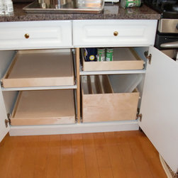 Pull Out Shelves and Pull Out Tray Bin - Pull out shelves and a try bin from ShelfGenie of Massachusetts.