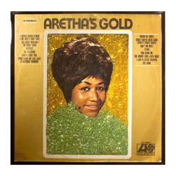 """Glittered Aretha Franklin Solid Gold Album - Glittered record album. Album is framed in a black 12x12"""" square frame with front and back cover and clips holding the record in place on the back. Album covers are original vintage covers."""