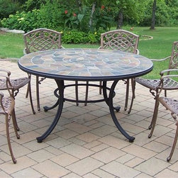 Oakland Living - Stone Art 7-Pc Patio Dining Set - Includes table, six arm chairs. Fade, chip and crack resistant. Solid and sturdy yet trendy designs. Brass hardware. Warranty: One year limited. Made from natural stone and rust free cast aluminum. Hardened powder coat finish in antique bronze. Minimal assembly required. Table: 54 in. Dia. x 29 in. H. Dining chair: 23 in. W x 22 in. D x 35.5 in. H (23 lbs.)Our stone art dining sets will be a beautiful addition to your patio, balcony or outdoor entertainment area. Stone art dining sets are perfect for any small space or to accent a larger space. The Oakland Stone Art Collection combines natural stone and modern designs giving you a rich addition to any outdoor setting.
