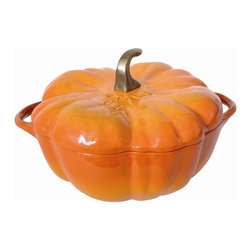 Staub - 3 1/2-Qt. Cast Iron Pumpkin Dutch Oven - The French oven is a timeless standby for stews, roasts, soups, casseroles and other one-pot classics. Staub has perfected this tradition in our signature ''La cocotte'' (co-cot) French Oven, the choice of some of the world's best chefs. The traditional round design has self-basting spikes for continuous, natural basting. When your meal is ready, La Cocotte moves beautifully from the stove to your table. Features: -Pumpkin cocotte.-Material: Cast iron.-Nickel knob for oven use.-Closed circuit and spikes cooking allows self basting.-Enameled black matte interior provides genuine flavor.-Smooth enamel bottom.-Constant and optimum performance.-Cast iron retains and evenly diffuses heat.-Induction hob compatible.-Perfect for stews, roasts, soups, casseroles and other one-pot classics.-Easy to clean.-Dishwasher safe but it is advised not doing this too often.-Resists up to 500 F.-Compatible with all heat sources.-Staub provides lifetime guarantee.-Made in France.-Capacity: 3 1/2-Qt..-Distressed: No.-Country of Manufacture: France.Dimensions: -Dimensions: 7.2'' H x 12.6'' W x 12.6'' D.