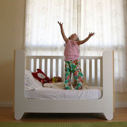 Spot on Square - Hiya Crib Conversion Kit - Designed by modern parents Bob and Nicole Springer (left) who believe in providing modern parents with new options in furniture for their modern tots, the Hiya Series was named after their son... a nickname given to him by his twin sister as soon as she could utter her first words. The Hiya series conveys a childlike sense of purity, simplicity and sustainability. Designed by: Bob and Nicole Springer Features: -White.-Made from recycled MDF.-Eco-friendly non-toxic paint.-Converts Hiya Crib to toddler bed.-Mattress not included.-Collection: Hiya Series.-Distressed: No.Assembly: -Some assembly required.