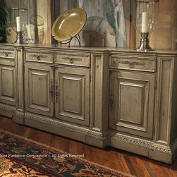 "Habersham - Habersham Biltmore Billiard Room 114 x 28 Sideboard - It all started in the small North Georgia town of Clarkesville. It was 1969 and Habersham founder Joyce Eddy had just been given the chance to operate a small antique shop located above an old laundromat. This was just the opportunity a woman of Joyce's vision and energy would turn into the perfect blend of utility artistry and soul. Looking for ways to make her antique business more profitable she began crafting small decorative purses from vintage wooden cigar boxes. They were totally unique and they were an instant hit. Joyce named her new venture Habersham Plantation after Georgia's Habersham County and the plantations for which the area was known. The ideas just kept coming. One day Joyce was driving by a local textile company and spotted a large pile of old discarded wooden spools. Those spools were soon crafted into candleholders towel racks and folk art items. With the help of her sons and other family members Joyce expanded Habersham's offerings to include handcrafted furniture reflecting the American Country designs of the early 17th and 18th centuries. As word spread and production demands grew Joyce enlisted the help of woodworkers from her North Georgia region. This area had been a center for cabinetmaking since the early 1800s and the master craftsmen were well-schooled in the time-tested woodworking and joinery techniques that matched Joyce's sense of style and function. She even designed her factory to work just as the 18th century cabinetmakers did with individual artisans hand-finishing signing and dating each piece of furniture they crafted. Today Habersham still leads the way in the fine art of furniture design. So much so that in addition to their product line a new ""whole home"" concept is finding its way into some of the finest dwellings in the country. Custom kitchen bath and other cabinetry designs offer rich opulent finishes and blend seamlessly with rooms of casual elegance all enhancing today's gracious lifestyle. Features include Top: 4 drawers Middle: 1 long adjustable shelf behind doors Ends: 1 adjustable shelf in each end behind doors."