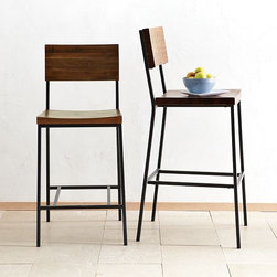 Rustic Bar Stool + Counter Stool - Rustic yet refined, these stools' owe their distinctive good looks to the rich grain and warm, inviting color of solid acacia wood. Raw steel legs add industrial style.