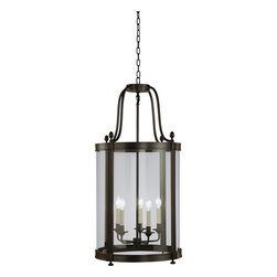 Robert Abbey - Blake Pendant, Deep Patina Bronze - Simply sophisticated! This pendant fixture features five candelabra arms encased within four glass panels to cast delicate light into your favorite setting. Available in a variety of finishes, it's an illuminating addition wherever you hang it.