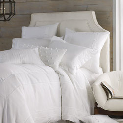 "Charisma - Charisma Knit Bolster Pillow with Ball Detail, 12"" x 32"" - Beautifully understated bed linens from Charisma® are made of snowy-white, satiny-soft cotton sateen. Dry clean. Imported. Dotted duvet covers and shams feature a gorgeously worked border treatment of cross-stitch embroidery. Duvet covers have a t..."