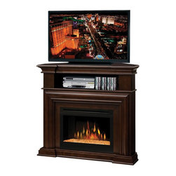 "Dimplex - Dimplex Montgomery Corner Entertainment Center Electric Fireplace Multicolor - G - Shop for Fire Places Wood Stoves and Hardware from Hayneedle.com! Warm up even the chilliest corner of your living room with the Dimplex Montgomery Corner Entertainment Center Electric Fireplace. Tradition meets function in this unique media console. Display your widescreen TV on top of the electric fireplace and store media components below it where they are easy to get to. Underneath all this action a sleek espresso-finished fireplace warms the room and gives it a special glow. Choose from inner glow logs molded from wood logs for incredible realism or a contemporary glass ember bed that creates an alluring fire on ice effect. You can enjoy it year-round because the flames operate with or without heat. The Montgomery electric fireplace is safe and green too. It doesn't produce carbon monoxide or other emissions and the glass screen stays cool to the touch. It's even safe for the youngest members of your family. Yes you can enjoy both TV and electric fireplace at the same time. Just find a comfy spot on the couch grab a mug of cocoa click the button and enjoy. You'll be the envy of all your neighbors. Don't be selfish - invite them over. About DimplexDimplex North America Limited is the world leader in electric heating offering a wide range of residential commercial and industrial products. The company's commitment to innovation has fostered outstanding product development and design excellence. Recent innovations include the patented electric flame technology - the company made history in the fireplace industry when it developed and produced the first electric fireplace with a truly realistic ""wood burning"" flame effect in 1995. The company since has been granted 87 patents covering various areas of electric flame technology and 37 more are pending. Dimplex is a green choice because its products do not produce carbon monoxide or other emissions."