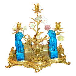 Antique French Candelabra - This antique French foo dog candelabra is an odd mix.