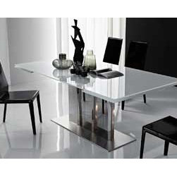 Plano Extendable Dining Table By Cattelan Italia - The Plano Extendable Dining Table is a charming piece of contemporary dining furniture. Experience a new style of dining with the table. With a very simple impressive design,the Plano Extendable Dining Table is a superb envious dining table that has the power to grab some attention during many occasions.