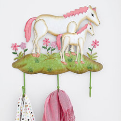 Pony Wall Hook - Add to the sweetness of your little girl's space with this pink pony wall hook. While you may never give her that pink pony she asks for with heartbreaking sweetness, you can give here these little buddies for hanging coats, bags, and even princess hats.